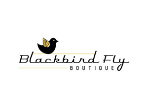 graphic of a black bird with a script that says Blackbird Fly