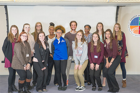 High school students participating in the Cuyahoga County Medical Examiner Shadow Program stand together for a group photo.