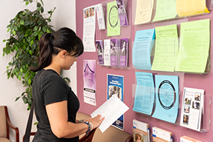 A woman looking at a booklet at the Family Justice Center