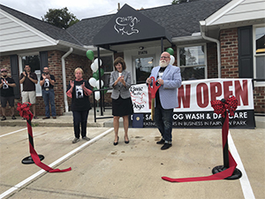 Mayor of Fairview Park, Ohio Eileen Patton and owners of Gone to the Dogs, Jeffrey Grano and Jan Gilson at the Gone to the Dogs ribbon cutting