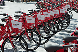 Red UHBikes lined up in a row