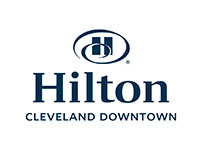 graphic of the letter H with a blue swirl around it and under it is the word Hilton