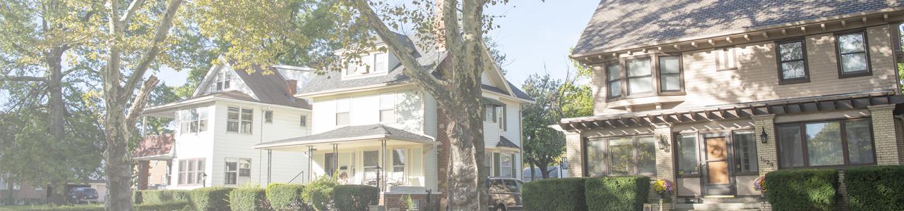 Neighborhood street view of 2 bungalow houses