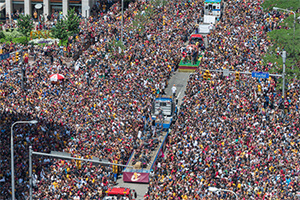 large group of people outside celebrating the Cavs