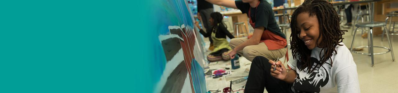 teens painting a mural