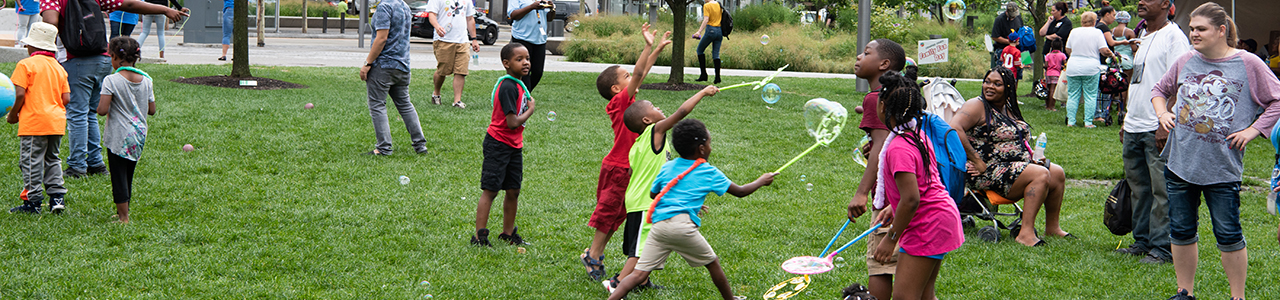 children making bubbles outside