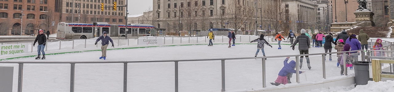 people iceskating at public square