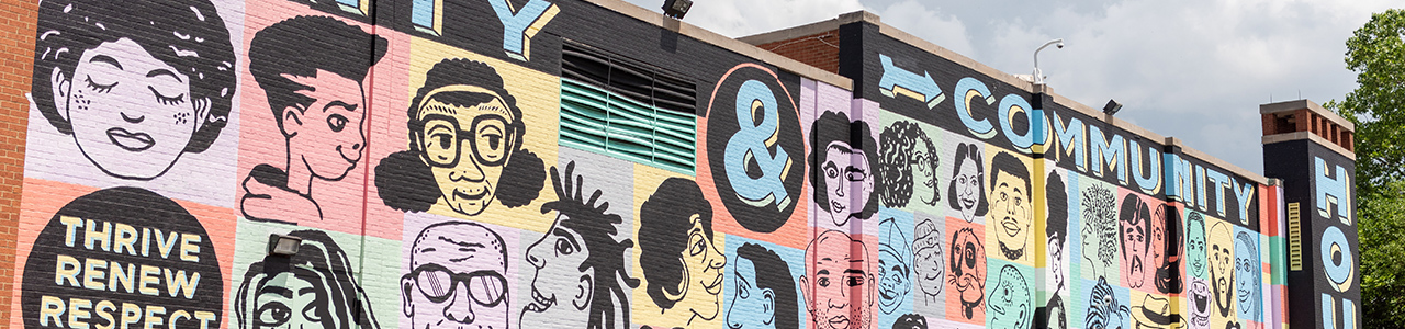 mural on a brick building that says Unity and Community