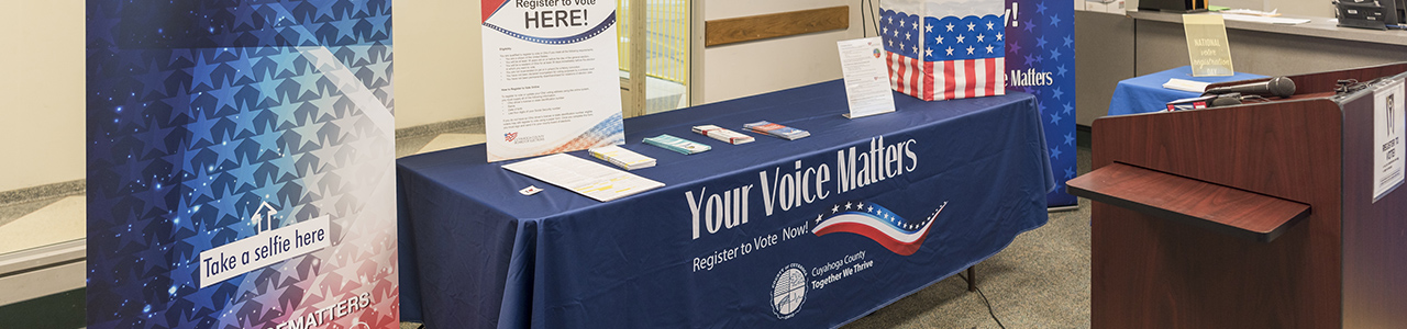 table with blue table cloth that has Your Voice Matters